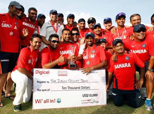 India players pose with their trophy and check after winning their three match series against the West Indies 1-0