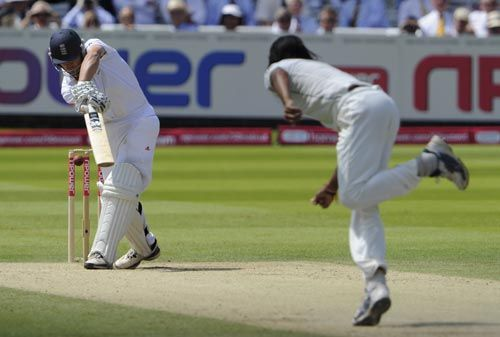 England's Jonathan Trott is bowled out by India paceman Ishant Sharma