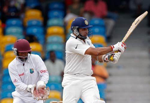 India batsman VVS Laxman (right) and West Indies wicketkeeper Carlton Baugh