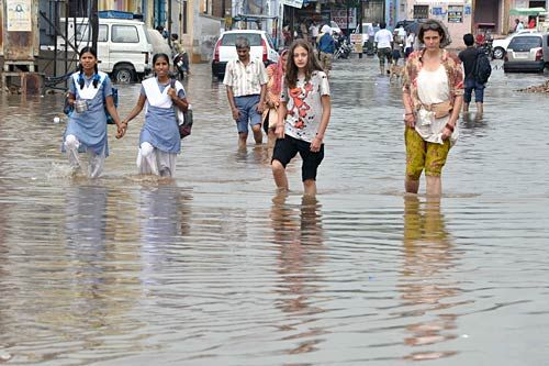 Foreign tourists enjoying monsoon rainfall