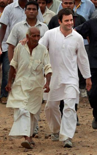 Rahul Gandhi interacts with a villager during his padyatra