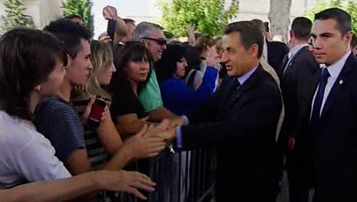 Sarkozy shaking hands with a crowd