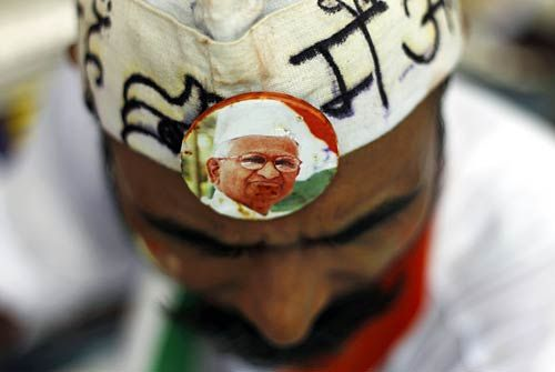 A supporter of Anna Hazare sports a badge.