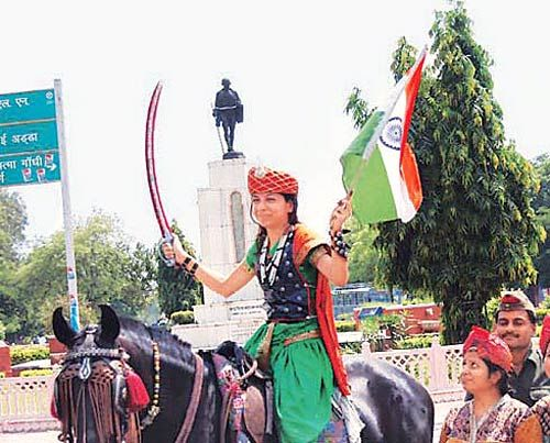 A protestor, dressed as Rani of Jhansi, joins the anti-corruption fight