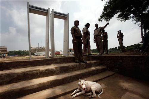 Delhi policemen stand near metal detectors at Ramlila Maidan in New Delhi