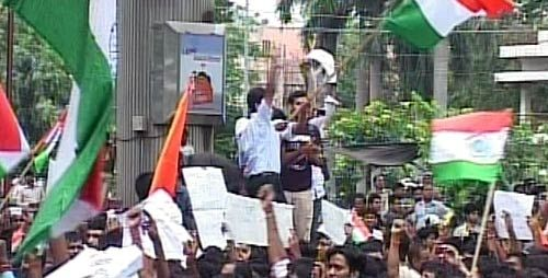Anna Hazare supporters wave national flag during protests in Delhi.