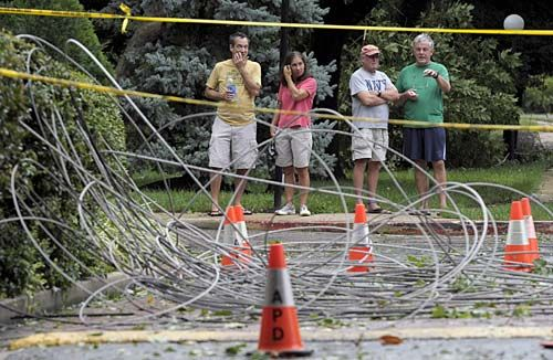 Residents of Annapolis, Md., look at downed power lines after Hurricane Irene