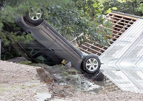 A car lies upside down in the aftermath of Tropical Storm Irene in Waterbury, Vt.