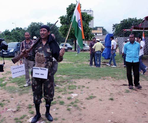 A local youth, dressed as a soldier, takes part in the protest in Jaipur