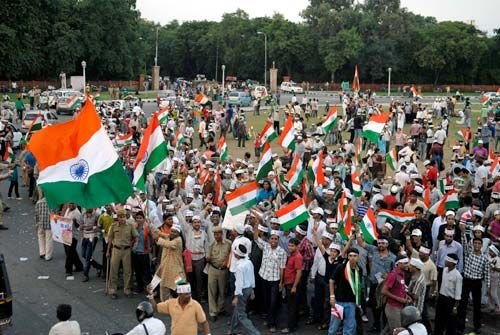 Supporters of Anna Hazare celebrate in Jaipur