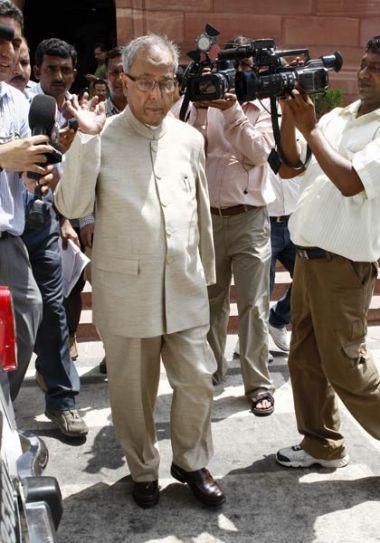 Finance Minister Pranab Mukherjee arrives to attend the Monsoon Season of Parliament
