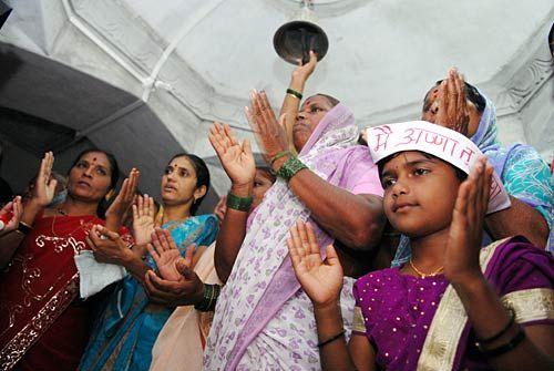 Villagers pray at Ralegan Siddhi