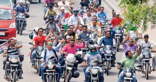 Anna supporters astride motorcycles in New Delhi.