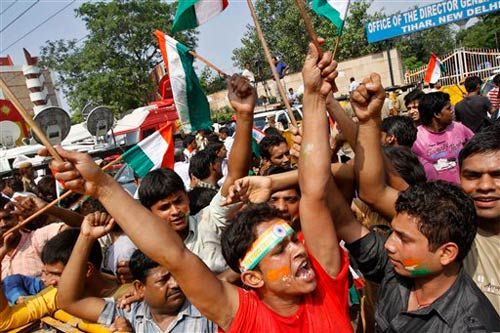 Supporters of Anna Hazare shout slogans outside Tihar prison