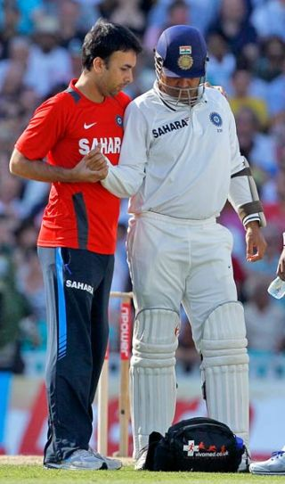 India's Virender Sehwag receives treatment on his shoulder