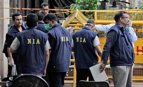 NIA officers at blast site