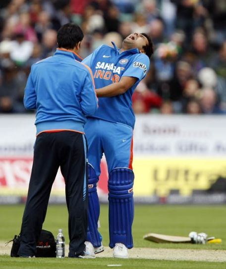 India's Rohit Sharma receives treatment
