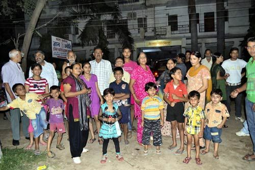 People standing outside their houses after earthquake