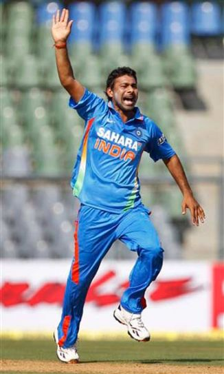 Praveen Kumar celebrates the dismissal of Craig Kieswetter