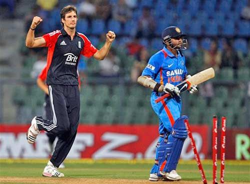 Steven Finn celebrates the dismissal of Parthiv Patel