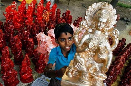 A child with idol of Goddess Lakshmi