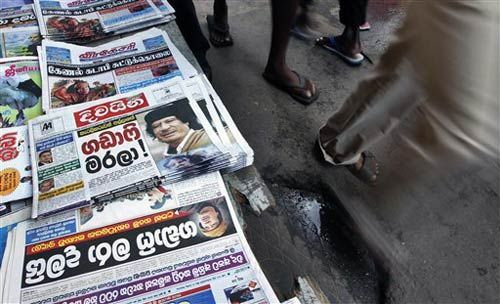 Sri Lankans read a newspaper