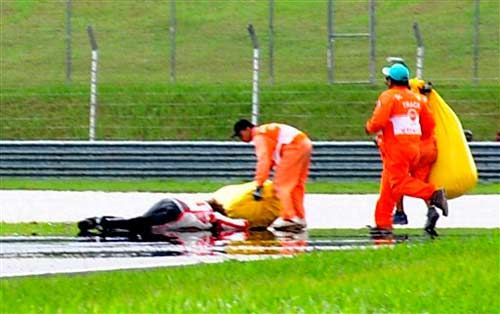 Marco Simoncelli lies on the track after the crash