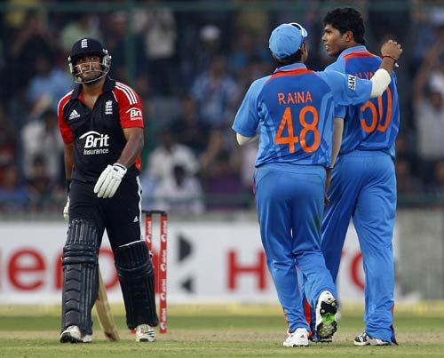 Samit Patel (left), Umesh Yadav (right) and Suresh Raina