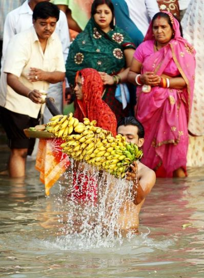 A devotee offers prayers during Chhath puja