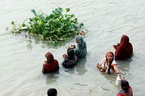 Devotees offer prayers during Chhath puja