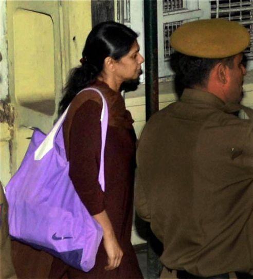 DMK MP Kanimozhi escorted at Patiala House court in New Delhi on November 28.