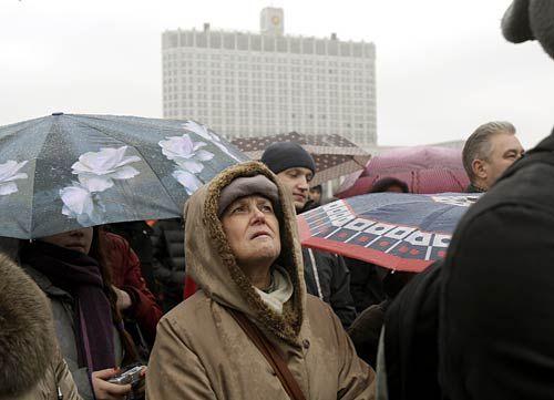 Russian listens to Vladimir Putin's speech.