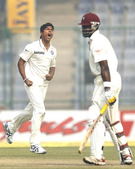 Umesh Yadav (left) and West Indies batsman Kirk Edwards