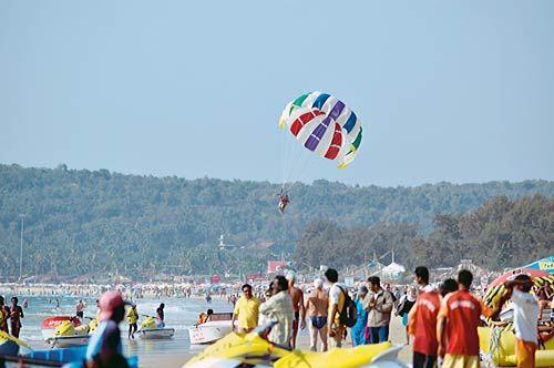 Tourists enjoy water sports