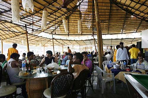 People eating in a Goan restaurant