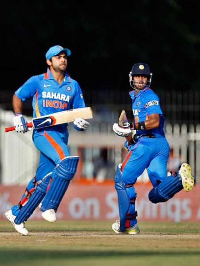 Virat Kohli (left) and Manoj Tiwary