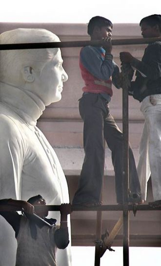 People cover Mayawati statues in Lucknow
