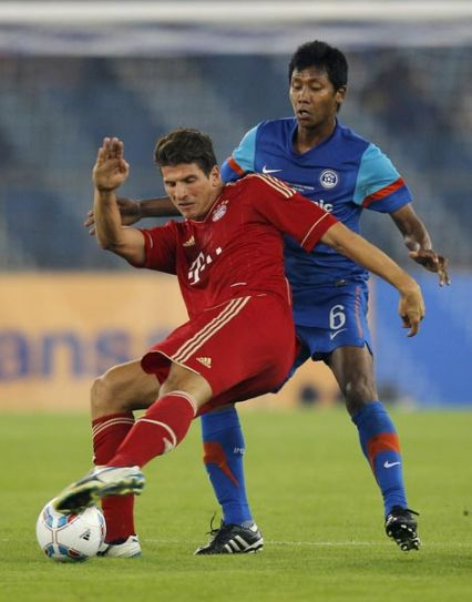 Thomas Muller (in red) and Govin Moirangthem Singh