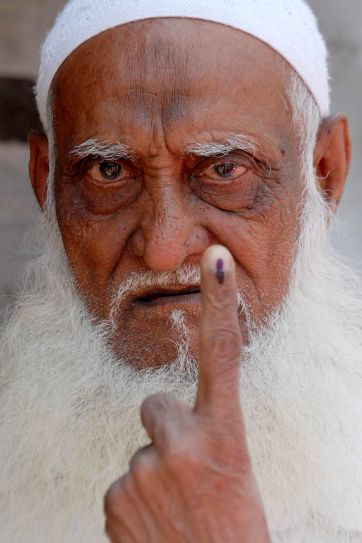 Elderly man poses after casting vote