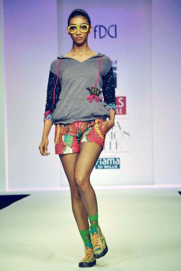 A model showcases a creation by designer Niharika