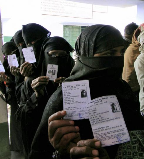 Women voters show their identity cards