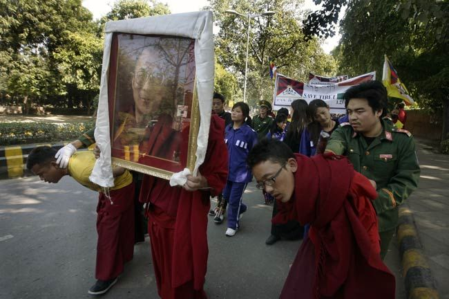 Tibetans take part in a mock protest in New Delhi