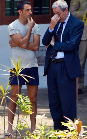 Massimiliano Latorre with an official