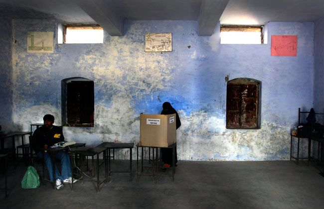 Muslim voter casts her ballot