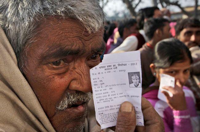 Elderly voter stands in a queue