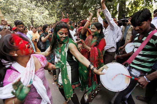 Samajwadi Party supporters dance to celebrate victory