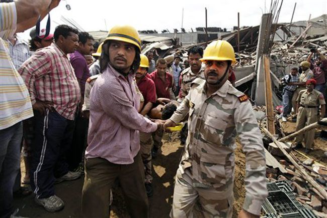Rescue officials at the site of the collapsed factory in Jalandhar.