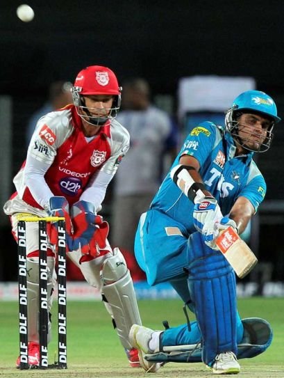 Sourav Ganguly (right) plays shot against Kings XI Punjab