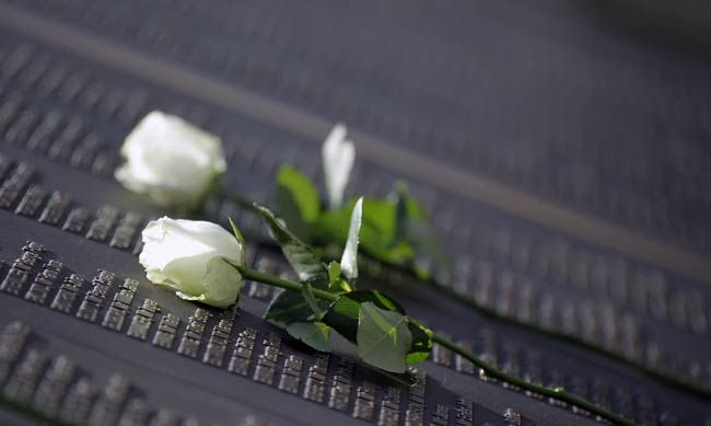 White roses are placed on the Titanic Memorial Plaque