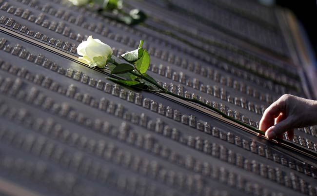 A rose rests on the new Titanic Memorial Plaque